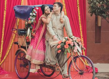 Photo of rickshaw with bride and groom