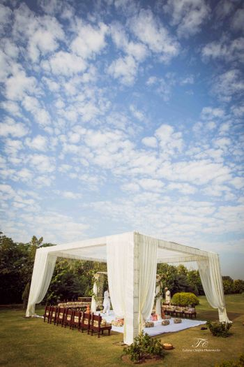 Photo of serene white mandap