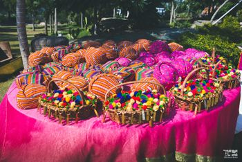 Pompoms in baskets as alternate to throw on couple