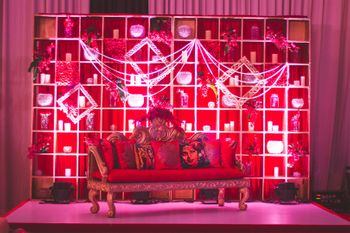 Bollywood theme sangeet stage decor with sofa