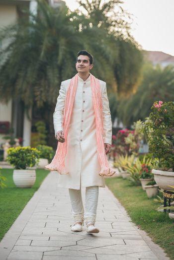 groom in ivory and peach sherwani