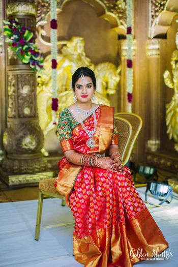Photo of South Indian bride in red kanjivaram and green blouse