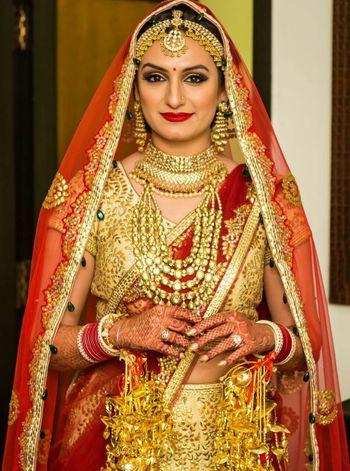 Photo of Akriti Kakkar in Crimson Bridal Lehenga