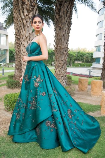 Photo of Strapless teal cocktail gown with floral motifs