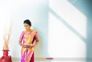 South Indian bridal portrait in pink and gold saree