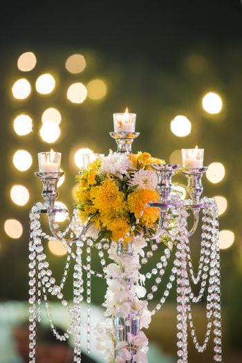 Photo of Centrepiece with candles and flowers