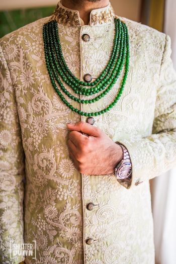 Silver grey floral print sherwani with contrasting necklace