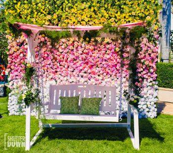 Floral wall Photo Booth with swing on mehendi