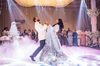 Couple dancing shot under the spotlight
