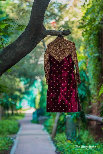 Embroidered velvet sherwani on hanger