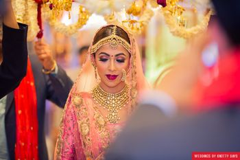 Bridal portrait entering under phoolon ki chadar