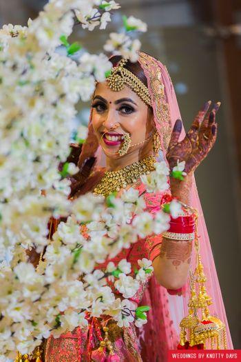 Happy bride shot against flowers