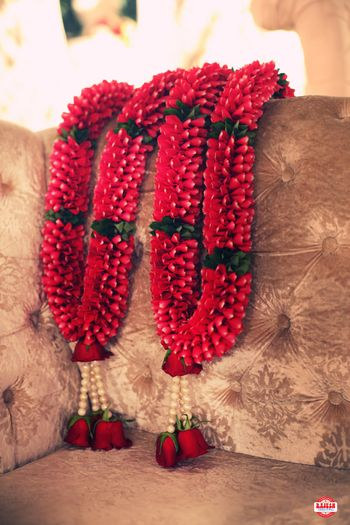 Red jaimala with hanging pearls and roses