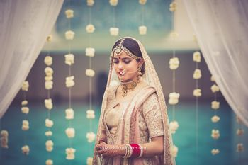 Bride in light grey bridal lehenga
