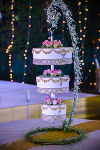 White three tier suspended wedding cake