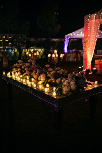 Candle stands and floral table centerpieces
