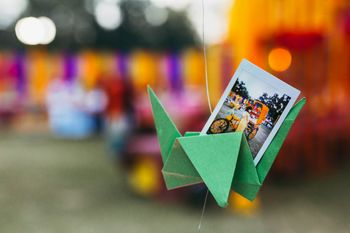 Ideas to display polaroids on hanging paper props