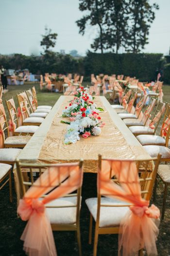 Photo of Backyard wedding decor with gold and peach theme