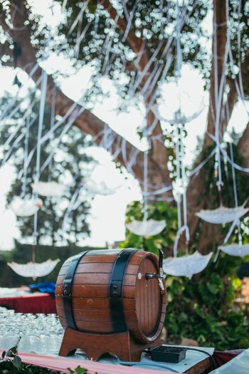 Photo of Food display idea with beer barrel for backyard wedding