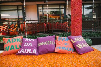 Colourful cushions with sayings for mehendi decor