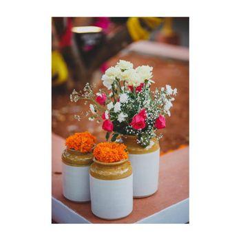 Pickle jars as vases with flowers