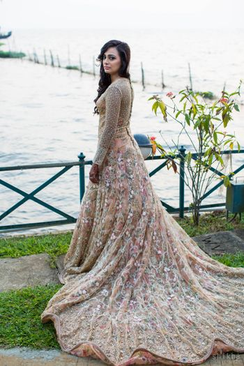 Peach gown with train and embellishments