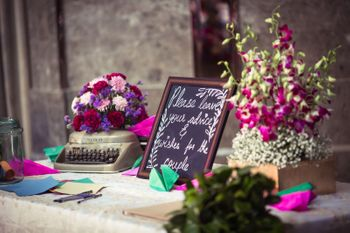 Table and props for guests to leave messages for the couple