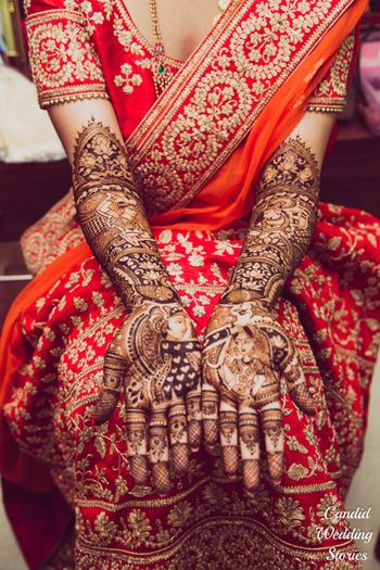 Bridal mehendi with half and half design with bride and groom portraits