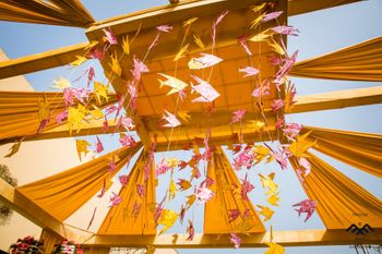 Modern mandap idea with hanging origami fish