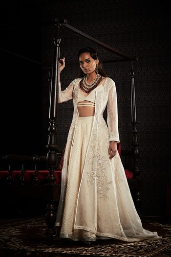 Photo of Offwhite lehenga with jacket