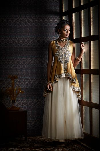 Photo of White lehenga with mustard peplum kurta