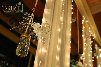 DIY decor idea hanging mason jars with florals