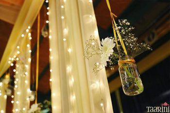 Hanging jars in decor with flowers