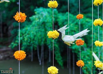 Hanging genga phool strings and paper decor elements