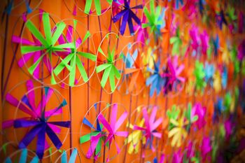Photo of Mehendi decor idea with pinwheel props