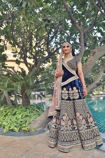 Navy blue velvet lehenga with pink dupatta and embroidery
