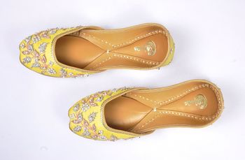 yellow juttis with pearl work