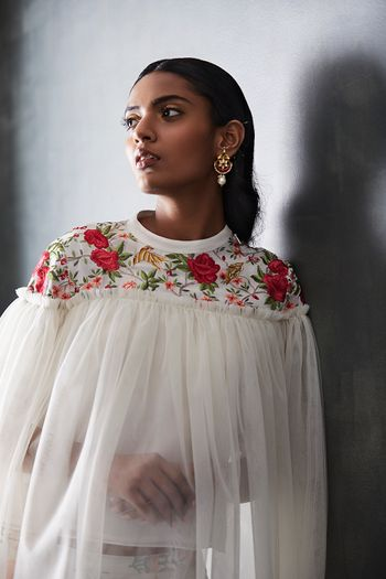 Photo of Floral embroidered cape in white