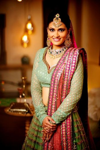 Photo of Mint green bridal lehenga with red dupatta for offbeat bride