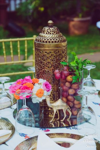Table centrepiece idea with mirror and fruits