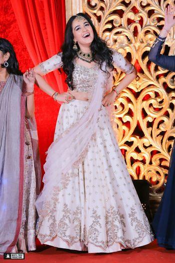 Photo of White lehenga with gold motifs for engagement