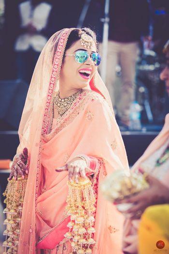 Bride wearing sunglasses and unique pearl kaleeras