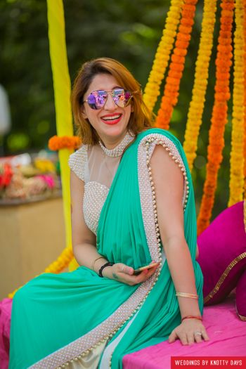 Pearl studded saree and blouse in turquoise and white