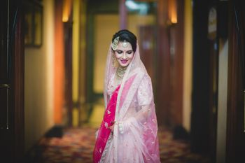 Photo of Bridal portrait pose with bride in pink