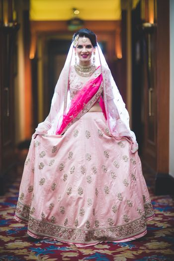 Photo of Light pink lehenga with bright pink dupatta