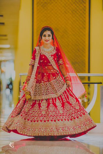 Photo of Twirling bride in red and gold