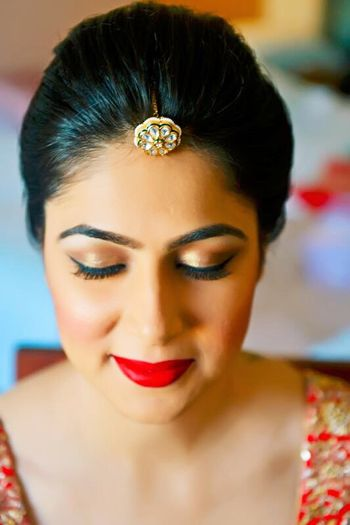 Dramatic red and gold makeup