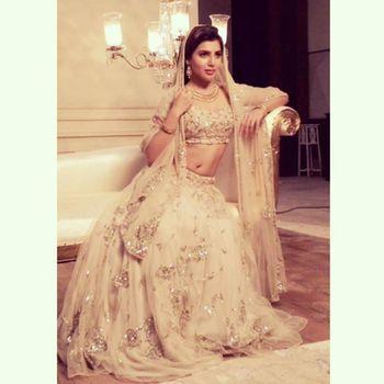Photo of cream bridal lehenga