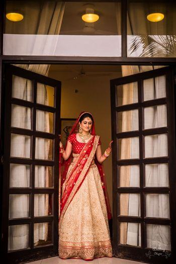 Photo of Simple bridal lehenga with red blouse and gold skirt