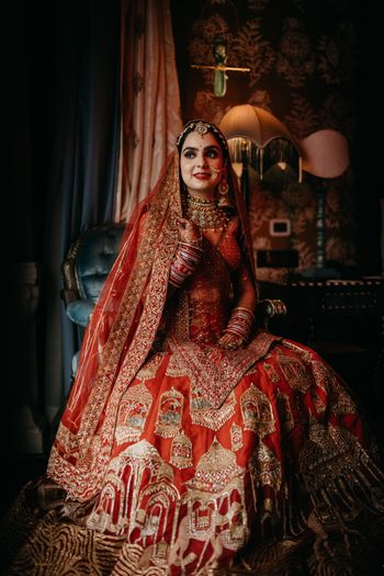 A bride wearing a traditional red lehenga